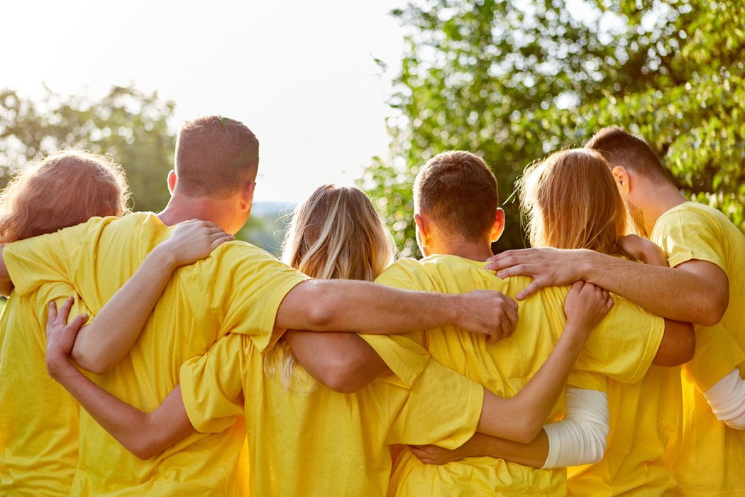 Six people hold each other in their arms